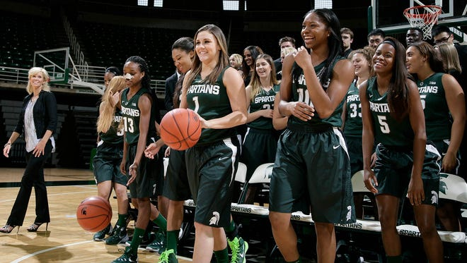 Players and staff scatter after sitting for their team photo during MSU women's basketball media day Wednesday, Oct. 28, 2015, in East Lansing, Mich.