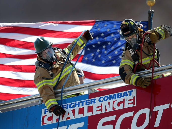 80 firefighters from across the country competed in Firefighter Combat Challenge Thursday afternoon next to Lucas Oil Stadium. Adam Robinson, from Westfield IN,left, competes with Kyle Righter,right, from Norwich (OH) Township Fire Department.