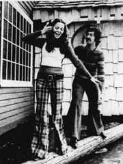 1972: Kim Loewenguth, a University of Rochester student, models purple plaid brushed denim peanut pants, with a super-low rise, while Mark Sinesiou models elephant bells with 40-inch bottoms. The outfits are from the Shed House.