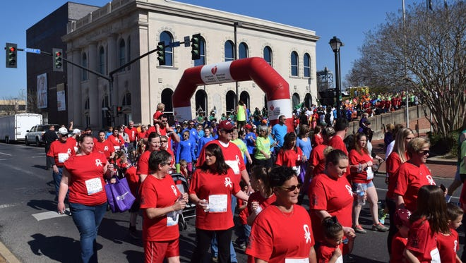 Sixty familiy members of the late Steve Blackwell wore red shirts as they walked in his memory in the American Heart Association/American Stroke Association Heart Walk held Saturday in downtown Alexandria. Blackwell died of a heart attack two years ago. Nearly 4,000 people participated in the 2016 Heart Walk.