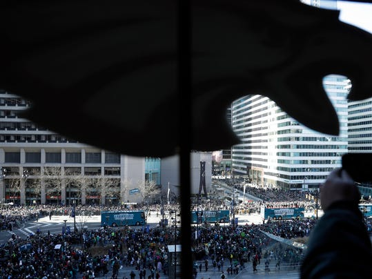 A fan takes a photo as the Philadelphia Eagles parade up Broad Street during a Super Bowl victory parade, Thursday, Feb. 8, 2018, in Philadelphia. The Eagles beat the New England Patriots 41-33 in Super Bowl 52. (AP Photo/Matt Slocum)