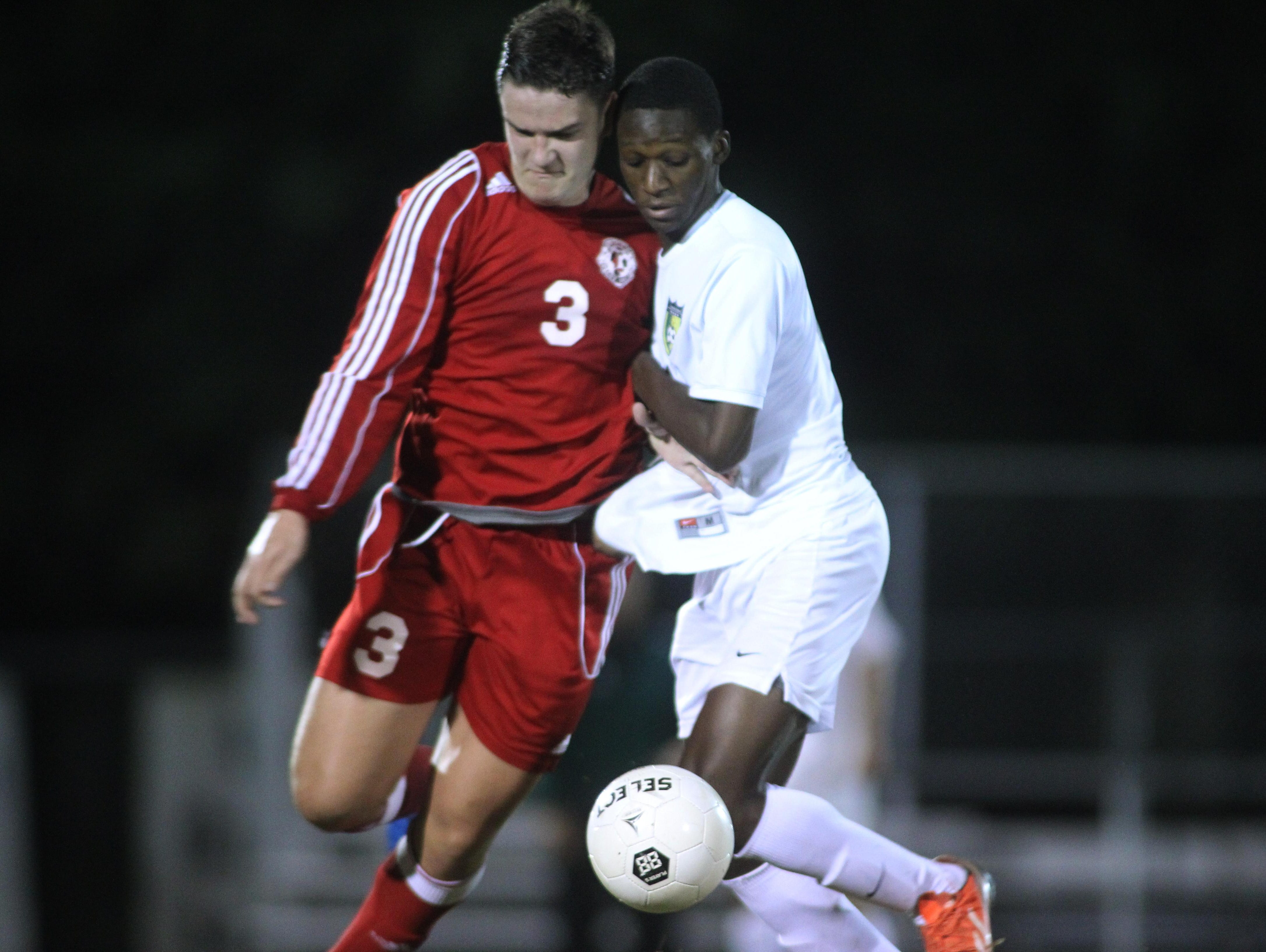 Leon's Carlton di Salvo takes on Lincoln's Chidie Otuonye for the ball in a game Tuesday.