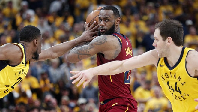 Indiana Pacers forward Thaddeus Young (21) knocks the ball away from Cleveland Cavaliers forward LeBron James (23) in the second half of Game 3 #of their NBA Eastern Conference playoff game on Friday at Bankers LIfe Fieldhouse.