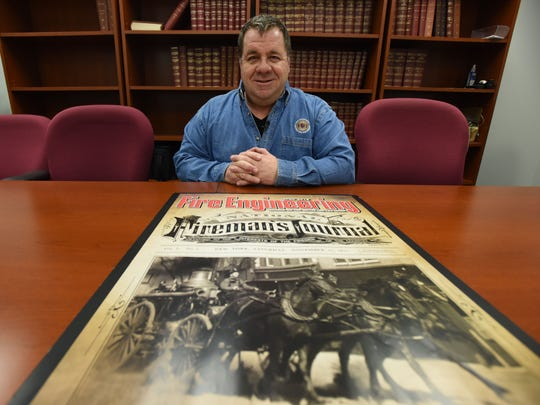 Eric Schlett, publisher of Fire Engineering, in the magazine's archive room, home to 141 years of firefighting history.