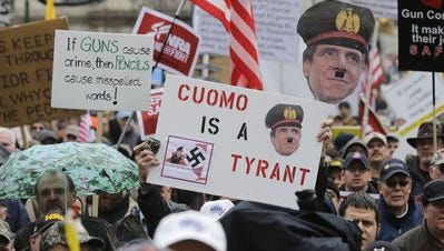 Gun rights advocates demonstrate in Albany in February 2013. While the state's new gun law ended dealer sales of popular AR-15 semi-automatic rifles in New York, arrest data show a boost in more than 1,000 gun possession charges in New York City to felonies.