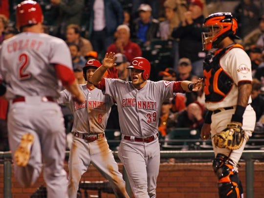 Devin Mesoraco (39) reacts as Zack Cozart (2) runs to home plate during the eleventh inning.