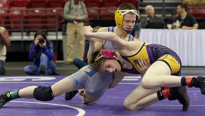 Mukwonago's Aaron Schulist  defeats Eau Claire North's Mason Phillips 6-5 in a tie-breaker  during the 113-pound semifinals of the WIAA state Division 1 state wrestling tournament Feb. 25 at the Kohl Center in Madison.