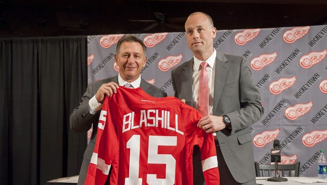 Jeff Blashill stands with GM Ken Holland as he is introduced as new Red Wings coach in June.