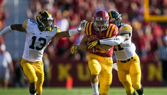 The Hawkeyes' Greg Mabin (No. 13) will have hands full Saturday against Pitt's Tyler Boyd.