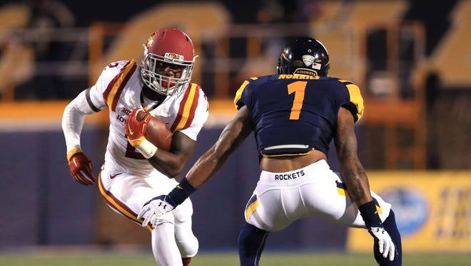 Iowa State running back Mike Warren tries to get by a defender at Toledo.