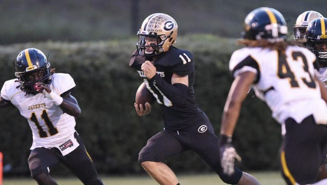Senior quarterback Mario Cusano (11) and the Greer Yellow Jackets will host the Union County Yellow Jackets in a Class AAA second-round game Friday night.