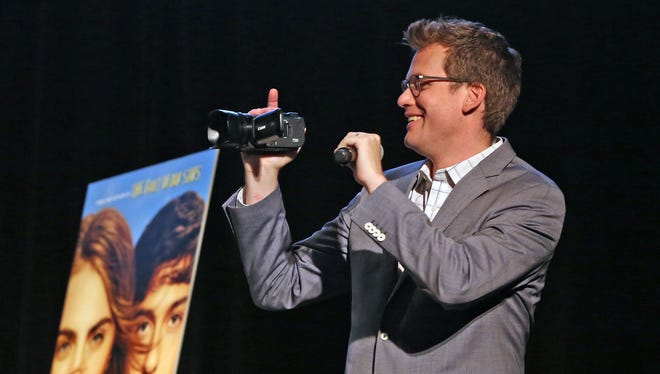 "John Green shoots video of the Murat Theatre in Old National Centre crowd during a July 14 promotional event for the film ""Paper Towns."""