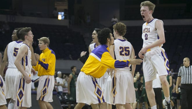 Mesa's Colter Galante (0) celebrates with his team after an early scoring run from Mesa over Basha during the Division I boys basketball state semifinal game at GCU Arena on Friday, Feb. 26, 2016.