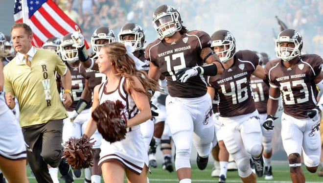 The Western Michigan Broncos take the field at Waldo Stadium before a game against Michigan State on Sept. 5, 2015.
