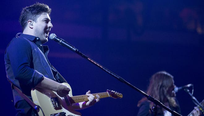 Marcus Mumford, left, and Winston Marshall perform with Mumford & Sons Sunday night at Bankers Life Fieldhouse.