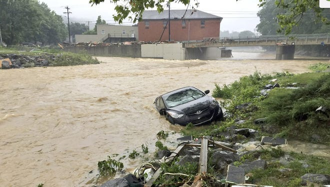 At Least 26 Dead As Historic Floods Sweep West Virginia