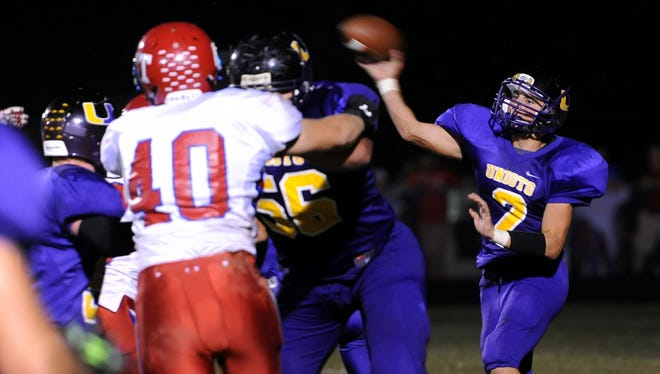 Unioto quarterback Clay Edler passes against Zane Trace at Unioto High School last season. Edler, a senior, will be looked upon to lead the Shermans' offense in 2016.