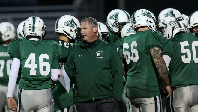 Brewster coach Ed Mulvihill talks to his team during its 11-7 victory over Rye at Brewster High School on Sept. 30, 2016.