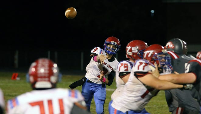 Zane Trace quarterback Austin Harris throws a pass against Westfall during Week 10 of this past season. Harris was named a Division V AP second-team all-Ohioan Wednesday night.