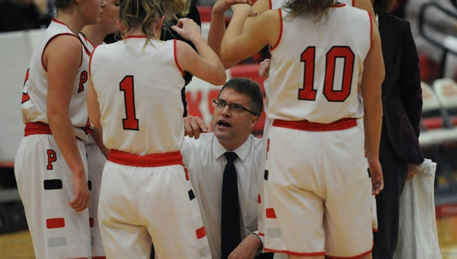 Piketon's Brett Coreno talks with his players during an earlier season contest at Piketon High School against Unioto.