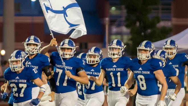 Harper Creek takes the field against Pennfield on Sept. 22.