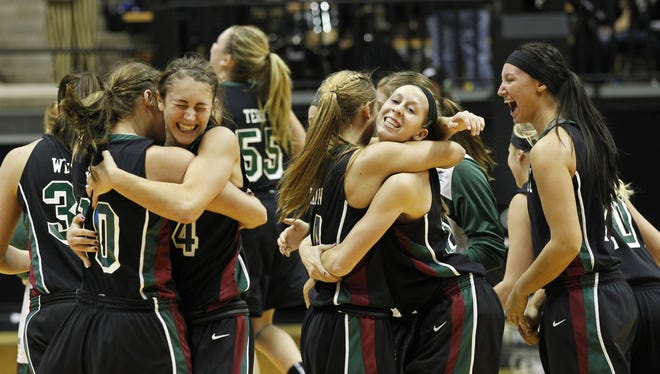 UWGB players celebrate after defeating Purdue 81-78 in double overtime.