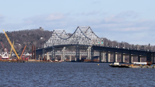 Construction barges and cranes surround the Tappan Zee Bridge March 31, 2014 as work continues on the building of the new bridge.