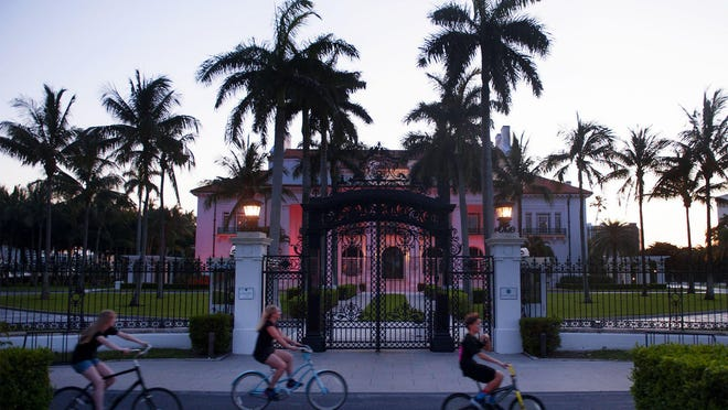The Flagler Museum is illuminated with red lights to show unity with and support for fellow destinations during the Palm Beaches National Travel & Tourism Week on May 5.