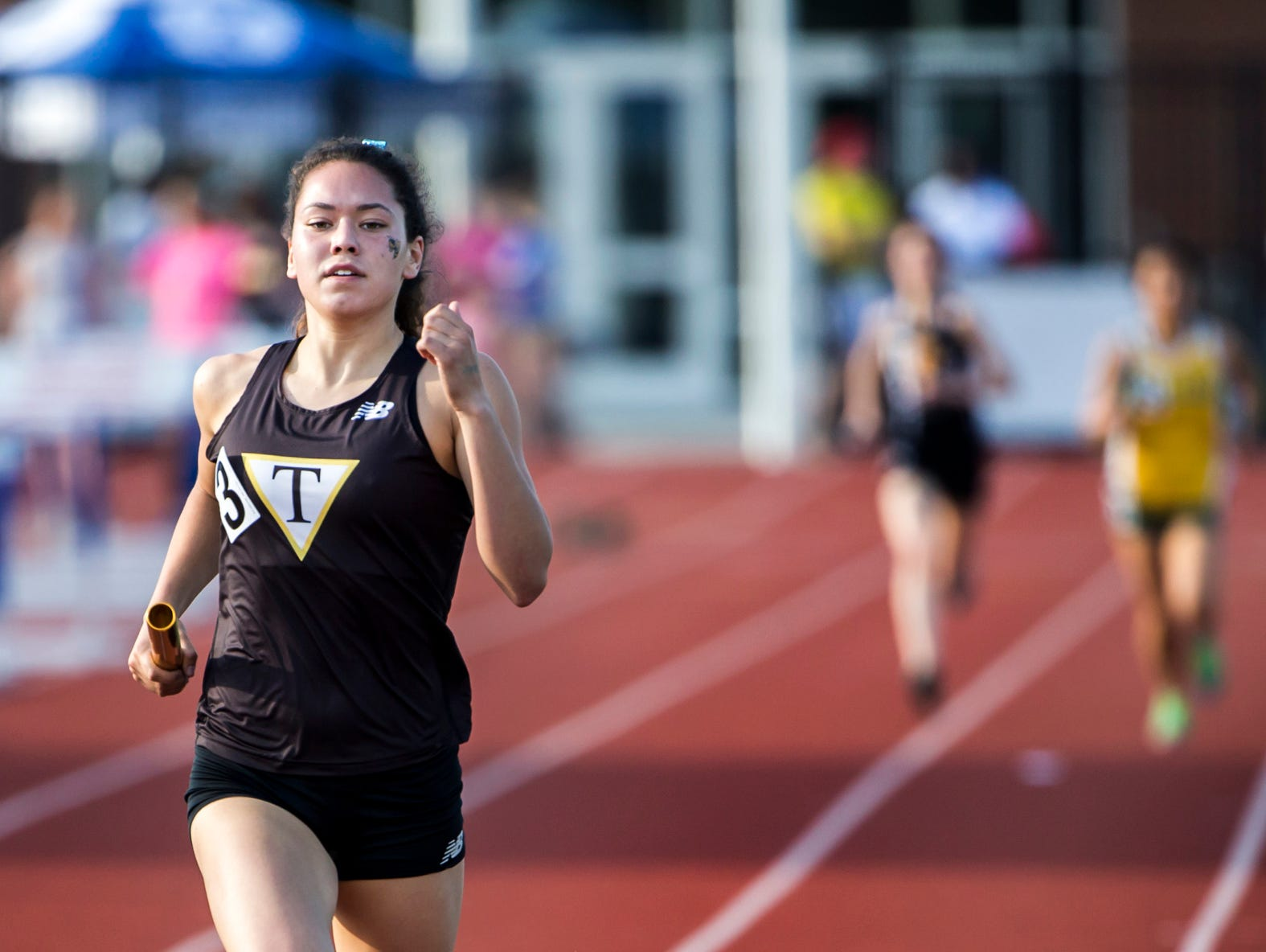 Tatnall's Savannah Pankow anchors her team to a win in the Girls 4x800 Meter Relay event at the Meet of Champions at Dover High School on Wednesday evening.