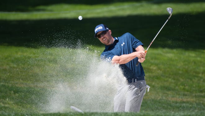 Hunter Mahan hits out of the bunker on the first hole during day one of the World Golf Championships-Cadillac March Play at TPC Harding Park.