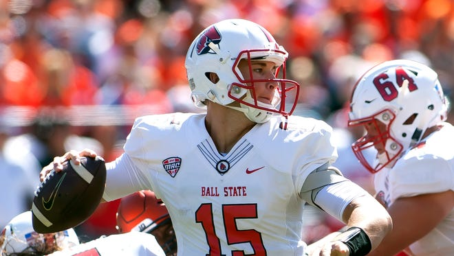 Ball State Cardinals quarterback Riley Neal sets up to pass during the first quarter against the Illinois Fighting Illini on Saturday, Sept. 2 at Memorial Stadium.