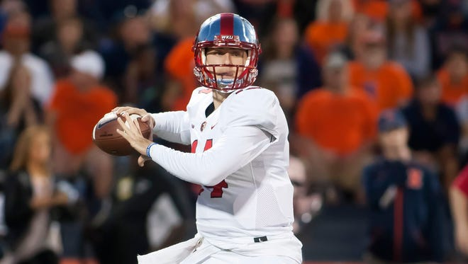 Western Kentucky Hilltoppers quarterback Mike White (14) sets up to pass against the Illinois Fighting Illini during the first quarter of a game Sept. 9 in Champaign, Illinois.