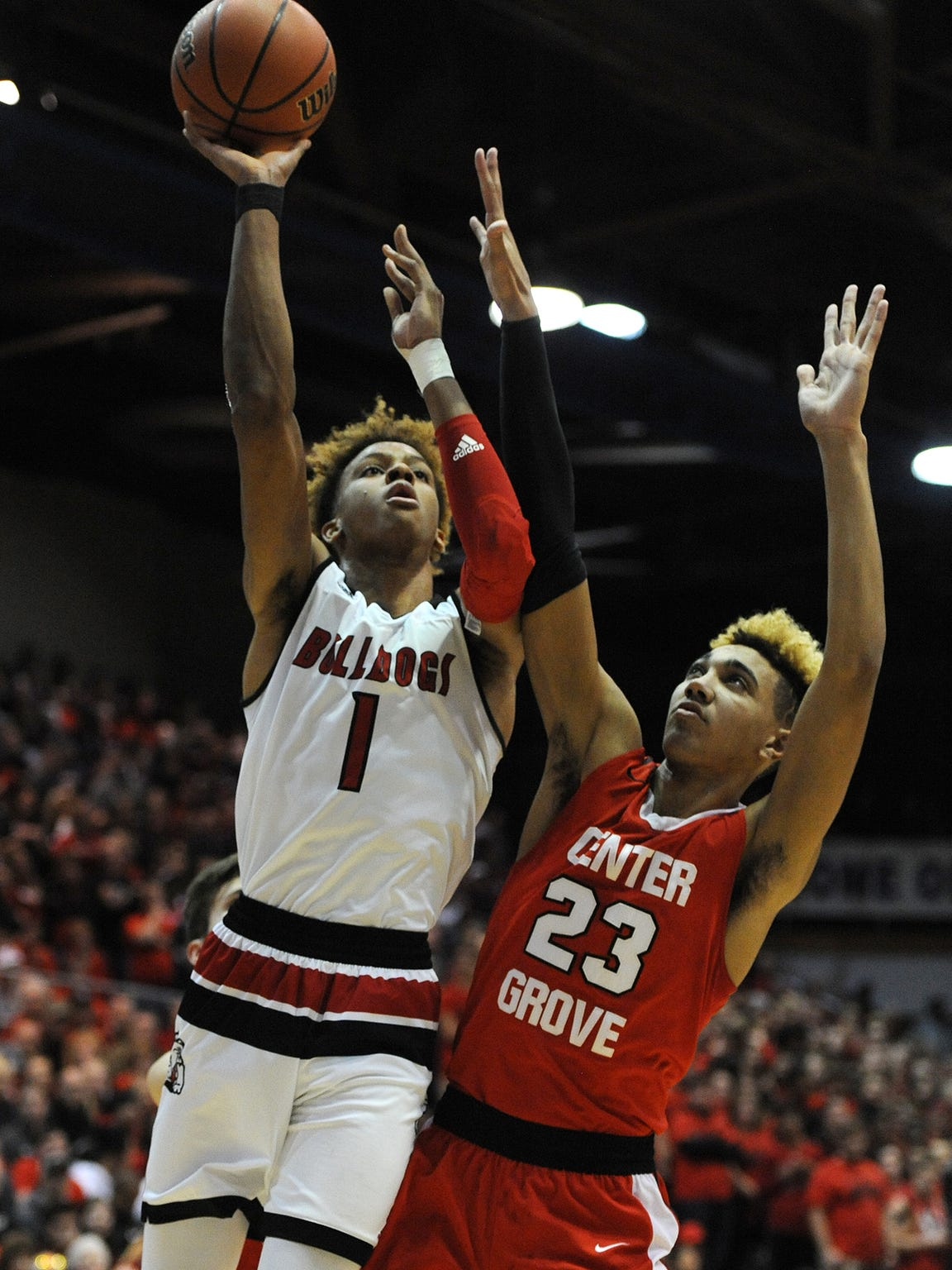 New Albany's Romeo Langford (left) shoots against Center Grove's Trayce Jackson-Davis (right) on Saturday during the Regional Final at Seymour High School. March 10, 2018.