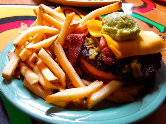 The Chachi's Works Burger is topped with cheese, bacon, green chile and guacamole, and comes with a side of fries. The restaurant, near New Mexico State University, also serves authentic Mexican food.