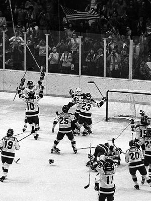 "Members of the U.S. hockey team celebrate their win Feb. 22, 1980, against the Soviet Union at the Lake Placid Olympics. The U.S. defeat of the heavily favored Soviet team quickly became known as the ""Miracle on Ice."""