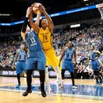 Minnesota Lynx' Lindsay Whalen (13) and Indiana Fever's Tamika Catchings (24) fight for the ball in the third quarter of a WNBA basketball game in Minneapolis, Tuesday, June 14, 2016.