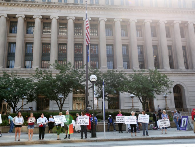 Protesters from both sides of the abortion debate demonstrated in front of the Hamilton County Courthouse in downtown Cincinnati as they waited for Judge Jerome Metz Jr. todecide if the Lebanon Road Surgery Center in Sharonville could remain open. Judge Metz ruled the clinic must close. The clinic has five days to appeal.