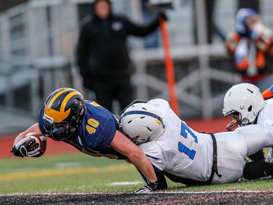 Dolgeville's Jordan Ortlieb is late on the tackle as Tioga's Trey Floyd stretches for a touchdown in the second quarter of the state quarterfinal.