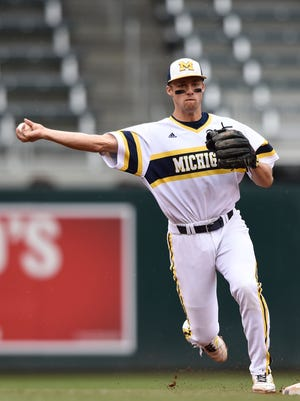 Michigan infielder Jake Bivens throws out Maryland's Anthony Papio at first base during the Big Ten tournament championship game May 24, 2015, in Minneapolis.