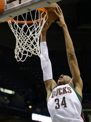 The Milwaukee Bucks' Giannis Antetokounmpo dunks during an NBA basketball game against the Los Angeles Lakers Wednesday, Feb. 4, 2015, in Milwaukee. For taxpayers, spending hundreds of millions on a new arena is no slam dunk.