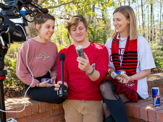 """Brandii Champagne, Sam Riehl and Emily Daigle are three UL Lafayette students competing in the Red Bull """"Can You Make It?"""" challenge to travel across Europe using only cans of the energy drink as currency."""