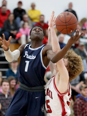 Bay Port guard Cordell Tinch drives past Pulaski's Pierce Narges on Jan. 16. The Pirates dropped to 10th from fifth in Division 1 after two losses last week.