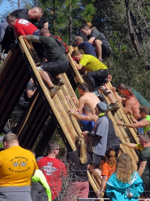 The Tough Mudder challenge was held Saturday in East Milton. Approximately 5,000 people were expected to attend the event that featured over twenty obstacles many with water filled pits and even one with electric shock. The event was held in East Milton near the Blackwater River Correctional Facility.