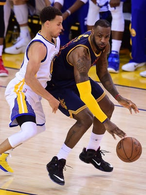 LeBron James of the Cleveland Cavaliers dribbles under pressure from Stephen Curry of the Golden State Warriors in last season's NBA Finals. The two teams meet again on Christmas Day.