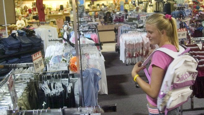 In this news-press.com file photo, Brooke Kretsch shops for clothes for the upcoming school year at Beall's in south Fort Myers during the tax-free sales holiday.