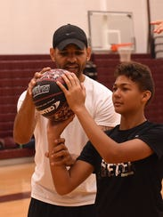 Greg Avery works with sixth-grader Xavier Ivery, 12,
