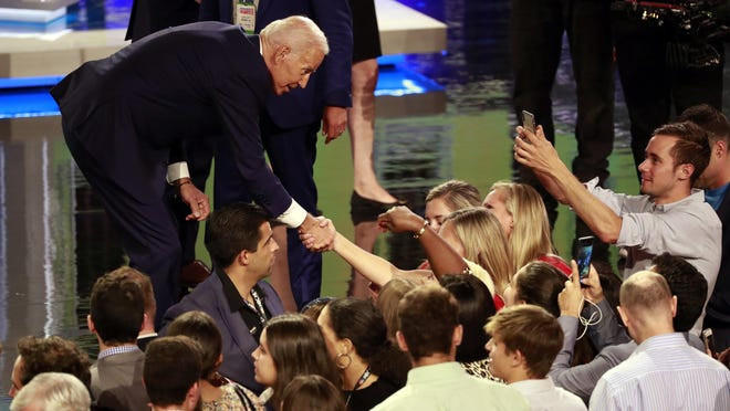 Democratic presidential candidate former vice president Joe Biden greets supporter after the Democratic primary debate hosted by NBC News at the Adrienne Arsht Center for the Performing Art, Thursday, June 27, 2019, in Miami. (AP Photo/Wilfredo Lee)
