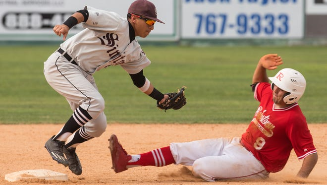 Sinton's Mike Mendez takes Robstown's Austin Kwiatkowski during their regional final series last  year. The two teams are expected to fight for the District 31-4A title this season and both have state tournament aspirations.