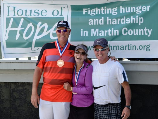 Dairy Queen Sponsors Robert and Janet Wesch who also played in the tournament, with director of tennis, Jeff Wilson