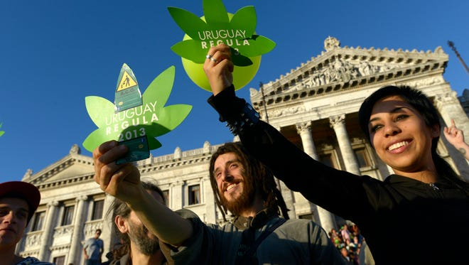 Activists gather in front of Uruguayan congressional headquarters as the Senate weighs legalization of marijuana in Montevideo on Tuesday.